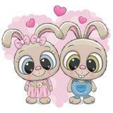 Conigli ragazzo e ragazza su un fondo del cuore Fotografia Stock