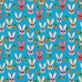 Coniglietti variopinti e carote su fondo blu royalty illustrazione gratis