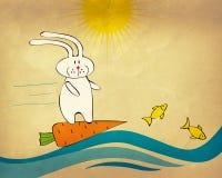 Coniglietto che pratica il surfing su una carota Fotografie Stock