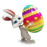 Coniglietto con l'uovo di coloritura Fotografia Stock