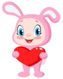 Coniglietto del bambino che tiene un cuore Immagine Stock