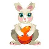 Coniglietto di pasqua che abbraccia un uovo di Pasqua Fotografia Stock Libera da Diritti