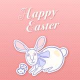 Coniglietto di pasqua con un arco e una coppia delle uova Fotografia Stock