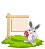 Coniglietto di pasqua e una scheda Fotografie Stock