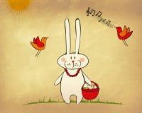 Coniglietto divertente con il cestino delle uova Fotografia Stock