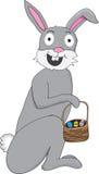 Coniglietto grigio con il canestro di pasqua Immagini Stock