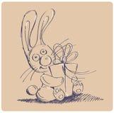 Coniglio con un regalo Fotografia Stock
