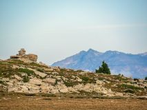 Cairn and mountain landscape in the French Pyrenees near the Pic du Canigou, Regional Park of the Catalan Pyrenees, France stock images