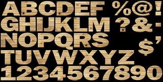 Conjunto - alfabeto de madera en un fondo negro ilustración del vector