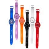 Conjunto colorido de relojes plásticos foto de archivo