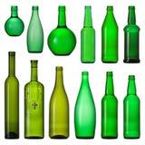 Conjunto de botellas de cristal verdes Foto de archivo libre de regalías