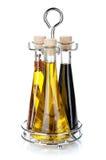 Conjunto de botellas del aceite y del vinagre de oliva Imagen de archivo libre de regalías