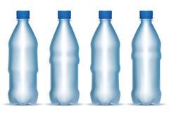 Conjunto de botellas del plástico transparente Fotografía de archivo libre de regalías