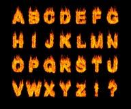 Conjunto de cartas latinas ardiendo del alfabeto Fotografía de archivo