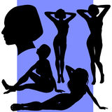 Conjunto de cinco siluetas femeninas Imagen de archivo