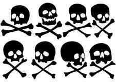 Conjunto de cráneos y de crossbones del pirata ilustración del vector