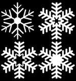 Conjunto de cuatro copos de nieve Imágenes de archivo libres de regalías