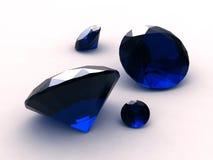 Conjunto de cuatro piedras preciosas redondas del zafiro Foto de archivo