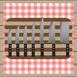 Conjunto de cuchillos Aislado en el fondo blanco Tabla-servilleta Vector de madera Tapa v Fotografía de archivo libre de regalías