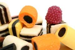 Conjunto de dulces de la fruta bajo la forma de batidores del vario color Foto de archivo libre de regalías