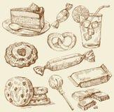Conjunto de dulces drenados mano Imagen de archivo