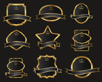 Conjunto de escrituras de la etiqueta oro-enmarcadas negras Imagenes de archivo