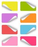 Conjunto de etiquetas engomadas coloridas en blanco Fotos de archivo