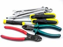 Conjunto de ferramentas de chave, de chave inglesa ajustável, de alicates e de chave de fenda Imagem de Stock