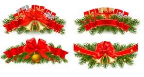 Conjunto de guirnaldas de la Navidad del día de fiesta con las cintas rojas Imagen de archivo