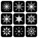 Conjunto de iconos con los copos de nieve Imagenes de archivo