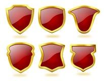 Conjunto de iconos de color rojo oscuro del blindaje con el marco de oro Imagen de archivo libre de regalías