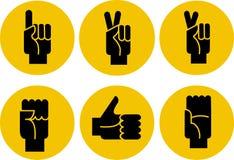 Conjunto de iconos de las manos negras en un fondo amarillo Fotos de archivo