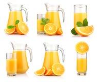 Conjunto de jarros y de vidrios de zumo de naranja Foto de archivo libre de regalías