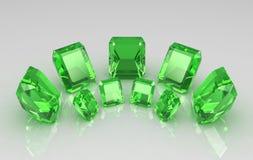 Conjunto de la esmeralda redonda siete en superficie brillante Fotografía de archivo libre de regalías