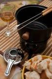 Conjunto de la 'fondue' Imagenes de archivo