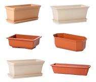 Conjunto de las macetas plásticas para las plantas de interior Fotografía de archivo libre de regalías