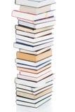Conjunto de libros aislados en un blanco Imagen de archivo