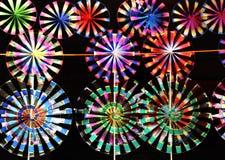 Conjunto de molinoes de viento del juguete del arco iris Imagenes de archivo