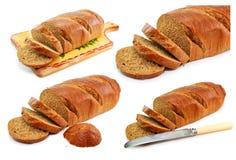 Conjunto de panes y de vajilla del trigo integral aislados Fotografía de archivo libre de regalías