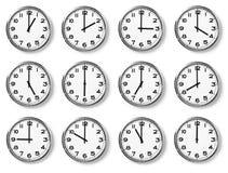 Conjunto de relojes de pared foto de archivo