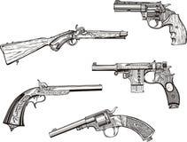 Conjunto de revólveres y de pistolas viejos Fotos de archivo libres de regalías