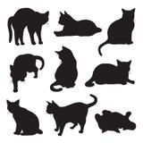 Conjunto de siluetas de los gatos Fotografía de archivo