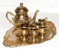 Conjunto de té de oro envejecido Imagen de archivo