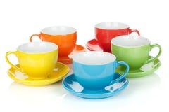 Conjunto de tazas coloridas imagenes de archivo