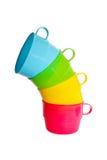 Conjunto de tazas del color imagenes de archivo