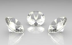 Conjunto de tres diamantes redondos hermosos Foto de archivo libre de regalías