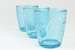 Conjunto de tres tazas azules Imágenes de archivo libres de regalías