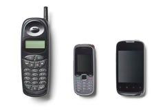 Conjunto de tres teléfonos celulares de la generación Imagenes de archivo