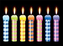 Conjunto de velas ardientes Imágenes de archivo libres de regalías