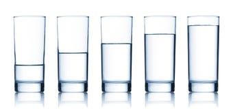 Conjunto de vidrios llenados de agua Imagen de archivo libre de regalías